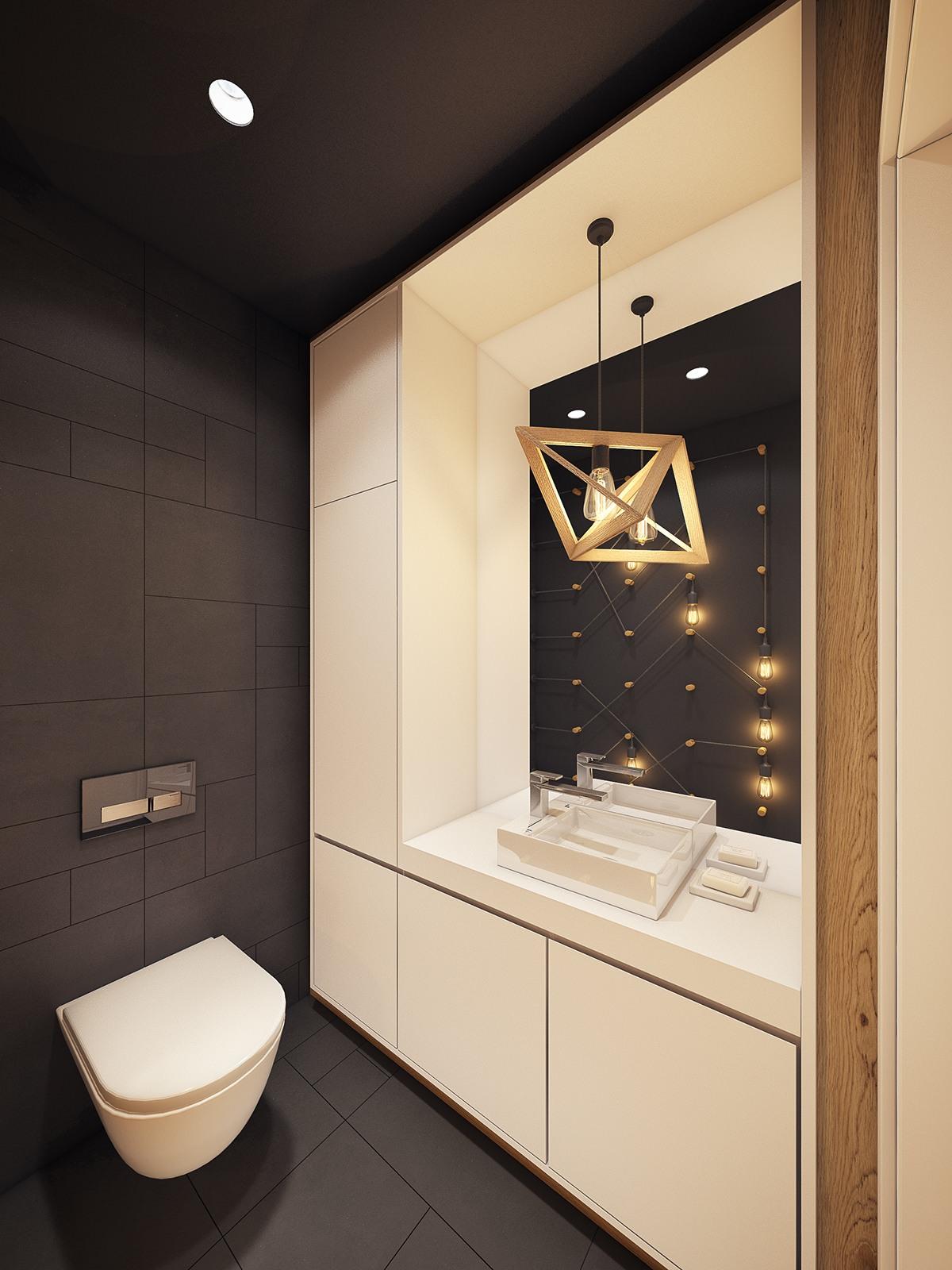 Chiếc đèn thả trần mang kiểu dáng hình học kết hợp cùng sự phản quang từ những chiếc đèn ghim tường độc đáo phía đối diện gương tạo nên vẻ ấn tượng và đẹp mắt cho không gian phòng tắm này.