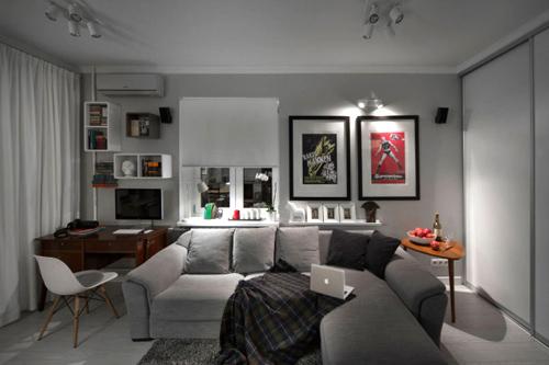 Căn phòng trở nên ấm áp và tiện nghi với chiếc sofa màu xám này